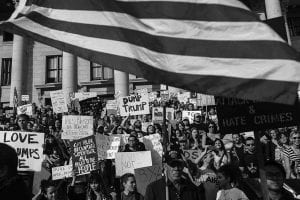 """Anti-Trump protesters rally at the Utah State Capitol during a """"Protests Trump"""" event in Salt Lake City on Saturday, Nov. 12, 2016. Tens of thousands of people marched in streets across the United States on Saturday, staging the fourth day of protests of Donald Trump's surprise victory as president. (Chris Detrick/The Salt Lake Tribune via AP)"""