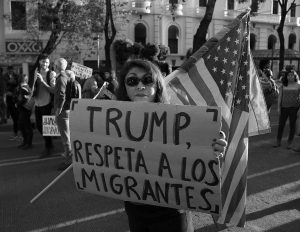 """A woman holds a sign that reads  in Spanish """"Trump, respect migrants"""" during a march called by a local women's movement against U.S. President Donald Trump in Mexico City, Friday, Jan. 20, 2017. Donald Trump became the 45th president of the United States Friday, Jan. 20 2017, amid apprehension in Mexico regarding his previous comments about Mexico and his promise to build a border wall to halt migration. (AP Photo/Eduardo Verdugo)"""
