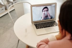 woman-in-a-video-call-with-a-covid-19-patient-4031710